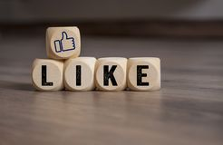 Cubes and dice with social media marketing i like it stock photo