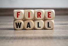 Cubes and dice with term FIREWALL stock photos
