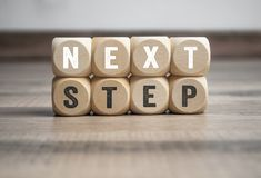 Cubes and dice with with term next step royalty free stock images
