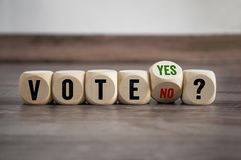 Cubes and dice with vote yes and no stock photo