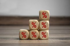 Cubes and dice on wooden background with percentage signs for special offer