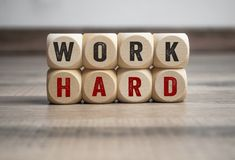 Cubes dice with work hard stock photography