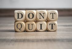 Cubes and dice with the words DONT QUIT and DO IT stock images