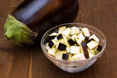 Cubes of eggplant on bowl on wood Royalty Free Stock Image