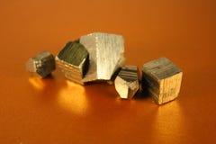 Cubes en or Photos libres de droits