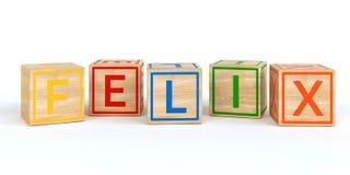 Cubes en bois d'isolement en jouet avec des lettres avec le felix de nom Image stock