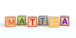 Cubes en bois d'isolement en jouet avec des lettres avec le mattia de nom Images libres de droits