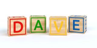 Cubes en bois d'isolement en jouet avec des lettres avec le nom dave Photo stock