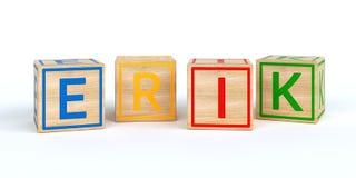 Cubes en bois d'isolement en jouet avec des lettres avec le nom Erik Photos libres de droits