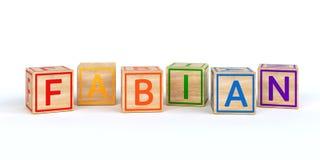 Cubes en bois d'isolement en jouet avec des lettres avec le nom fabian Images libres de droits