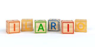 Cubes en bois d'isolement en jouet avec des lettres avec le nom Ilario Image libre de droits