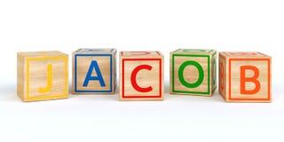 Cubes en bois d'isolement en jouet avec des lettres avec le nom Jacob Photo stock