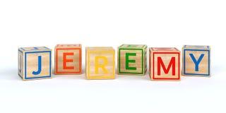 Cubes en bois d'isolement en jouet avec des lettres avec le nom jeremy Photos libres de droits