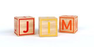 Cubes en bois d'isolement en jouet avec des lettres avec le nom JIM Photo libre de droits