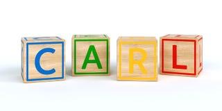 Cubes en bois d'isolement en jouet avec des lettres avec le nom Karl Photo libre de droits