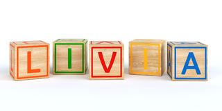 Cubes en bois d'isolement en jouet avec des lettres avec le nom Louis Images stock