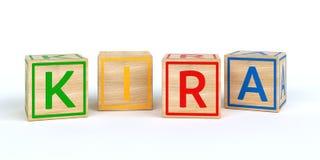 Cubes en bois d'isolement en jouet avec des lettres avec le nom Louis Photo libre de droits
