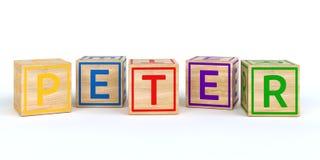 Cubes en bois d'isolement en jouet avec des lettres avec le nom peter Photo libre de droits