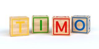 Cubes en bois d'isolement en jouet avec des lettres avec le nom Timo Image stock