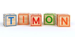 Cubes en bois d'isolement en jouet avec des lettres avec le timon de nom Images stock