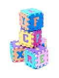 Cubes en lettre de mousse Photographie stock