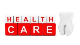 Cubes en soins de santé avec la dent Photos stock