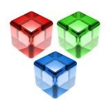 Cubes en verre vert-bleu rouges d'isolement Photographie stock