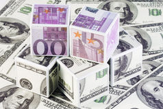 Cubes of euros and dollars. Isolated on the background notes Stock Photo