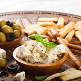 Cubes of feta cheese with olives Stock Image
