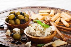 Cubes of feta cheese with olives Royalty Free Stock Photos