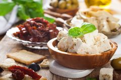 Cubes of feta cheese with olives Stock Photography