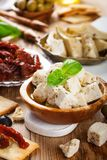 Cubes of feta cheese with olives Stock Images