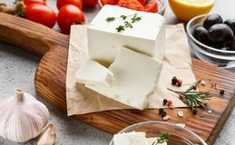Cubes of feta and spices on board royalty free stock images
