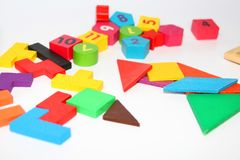 Cubes and figures with numbers laid out randomly on a white background stock photos