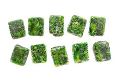 Cubes of frozen spinach on the white background Stock Photo