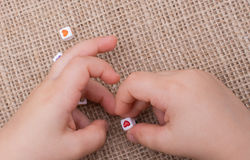 Cubes with heart shape in hand on canvas Stock Photos
