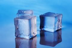 Cubes of ice on the blue background Royalty Free Stock Photo
