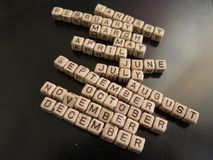 The names of the months collected from wooden cubes with letters royalty free stock photography