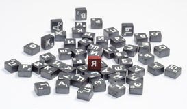 Cubes with letters. Metal cubes with letters isolated on white background Royalty Free Stock Photos