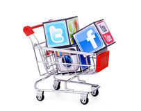 Cubes with logotypes of social media. Facebook, Twitter, instagram, placed into shopping cart stock illustration