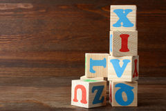 Cubes. A lot of different wooden cubes with letters on a brown wooden background Stock Photography