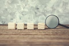 Cubes with magnifier royalty free stock photos