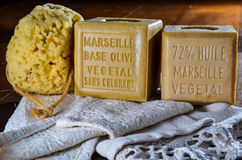 Cubes of marseilles natural soap with sponge and bath towel Royalty Free Stock Images