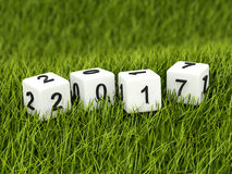 Cubes with 2017 New Year sign on grass. 3D illustration Stock Image