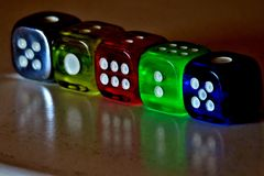 Cubes with numbers of different colors glow in the dark royalty free stock images