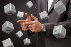 Cubes with percent falling on the background of the businessman. The concept of discount and discounts Stock Photography
