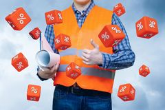Cubes with percent fly on the background of the Builder. The concept of the promotion discount Stock Images