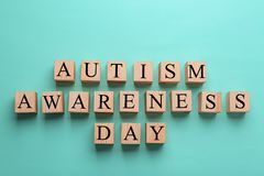 Cubes with phrase. `Autism awareness day` on color background Stock Photography