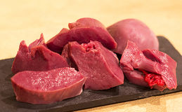 Cubes of raw beef. Raw beef chopped into pieces for a stew Royalty Free Stock Images