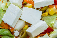 Feta cheese in a fresh mixed salad Stock Image